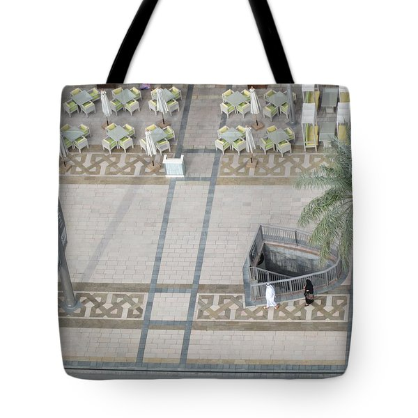 Tote Bag featuring the photograph The Money Is Here But Where Are All The People Besides These Two by Marie Neder
