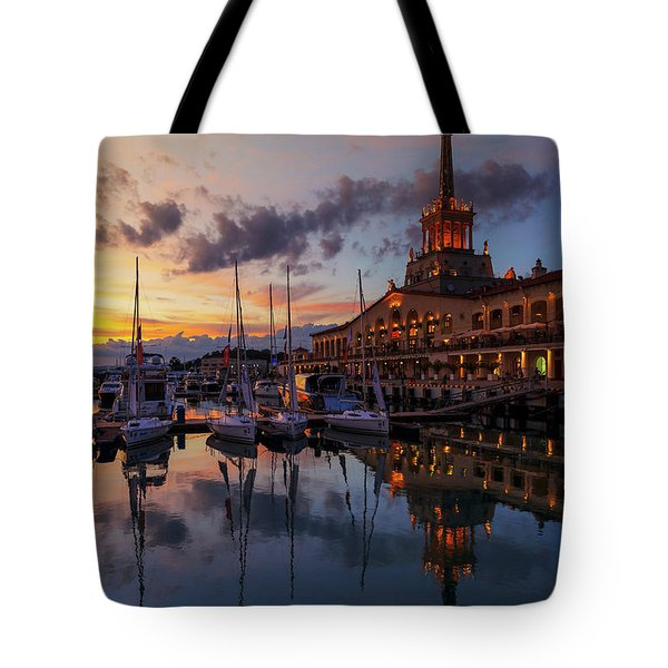 the nautical station and the yacht on the main sea channel of the Sochi seaport Tote Bag