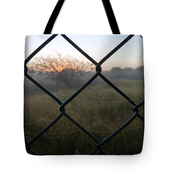 Tote Bag featuring the photograph The Outlander by Jeremy Holton