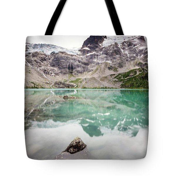 Tote Bag featuring the photograph The Peak In A Turquoise Lake by Pierre Leclerc Photography