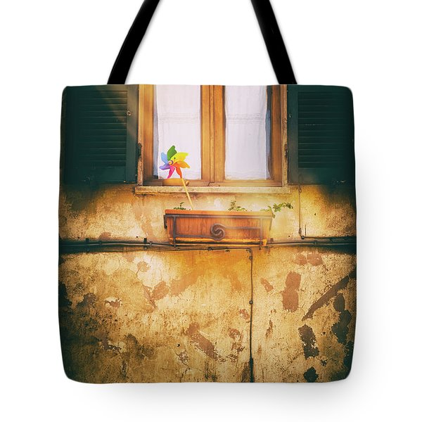 Tote Bag featuring the photograph The Pinwheel by Silvia Ganora