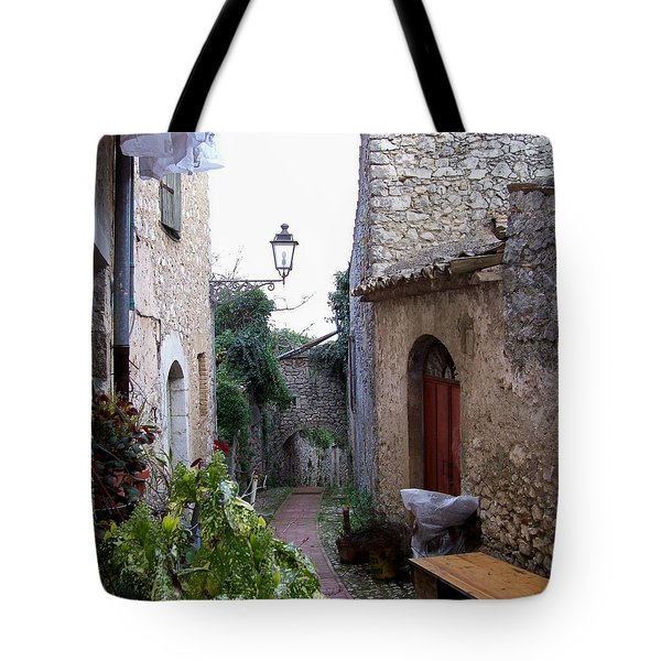 Tote Bag featuring the photograph The Red Door by Judy Kirouac