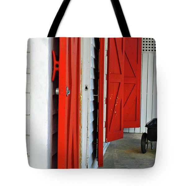 Tote Bag featuring the photograph The Red Doors by Jost Houk