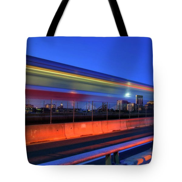 Tote Bag featuring the photograph The Red Line Over The Longfellow Bridge by Joann Vitali