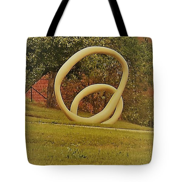 Tote Bag featuring the photograph the rings of Mactown by Aaron Martens