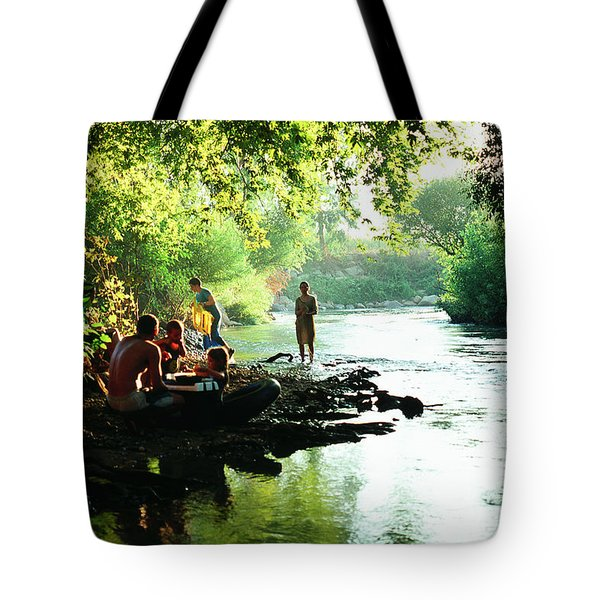 Tote Bag featuring the photograph The River by Dubi Roman