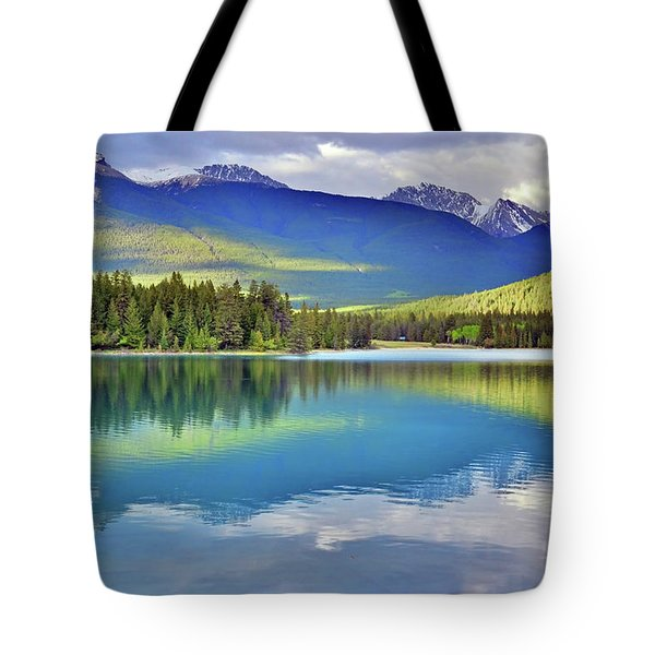 Tote Bag featuring the photograph The Rockies Reflected In Lake Annette by Tara Turner