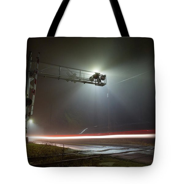 Tote Bag featuring the photograph The Speed Of Light by Brian Hale