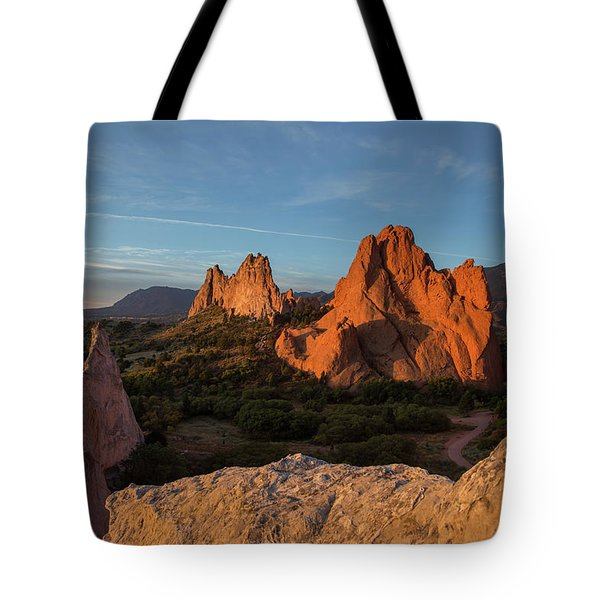 The Sun Illuminates The Red Rock Formation At The Garden Of The  Tote Bag