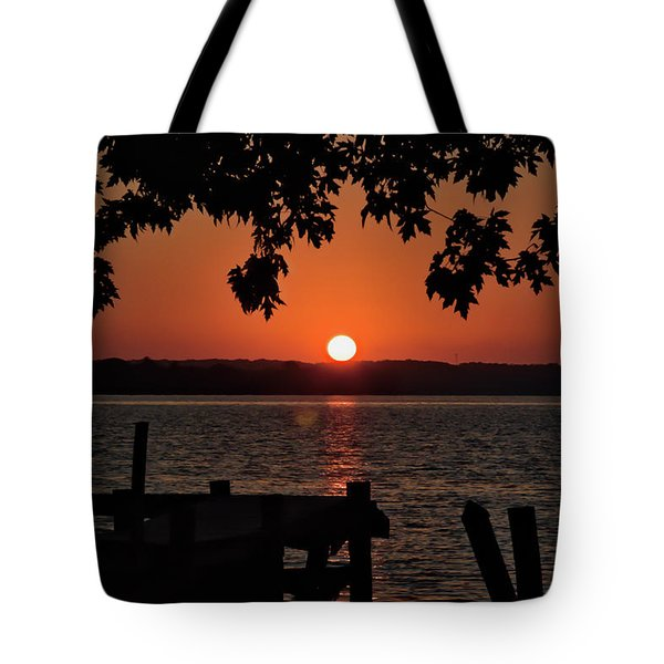 Tote Bag featuring the photograph The Sun Rises Over The Bay by Mark Dodd