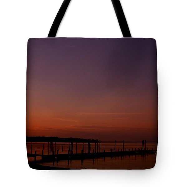 The Sun Sets Over The Water Tote Bag