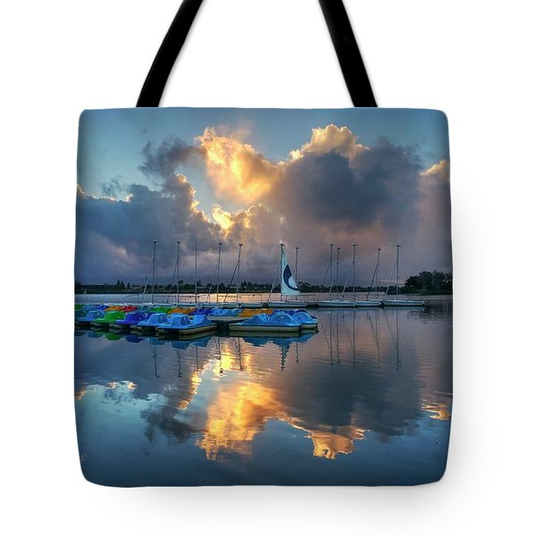 Tote Bag featuring the photograph The Sun Settles At The Shoreline by Peter Thoeny