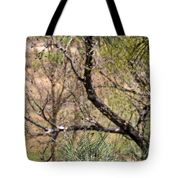 Tote Bag featuring the photograph The Swarm by Donna Kennedy