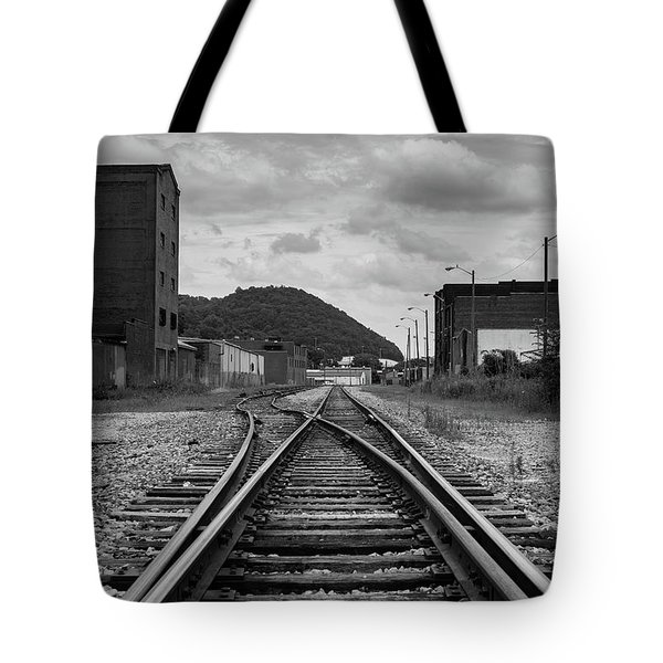 Tote Bag featuring the photograph The Tracks by Break The Silhouette