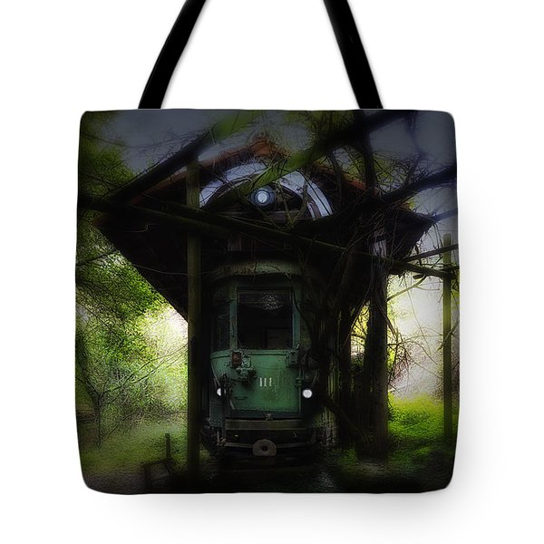 Tote Bag featuring the photograph The Tram Leaves The Station... by Enrico Pelos