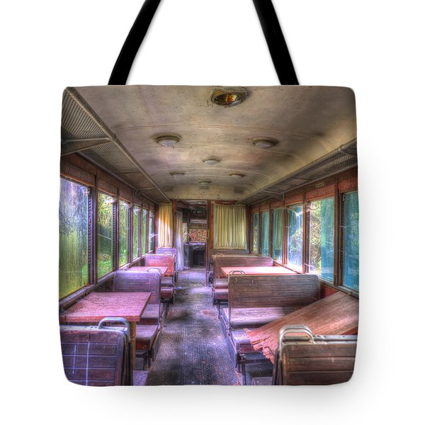 Tote Bag featuring the photograph The Tram Leaves The Station... Inside by Enrico Pelos