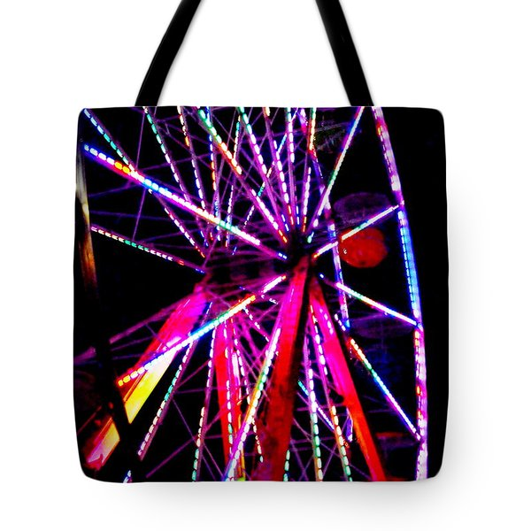 Tote Bag featuring the photograph The Wheel by Jesse Ciazza