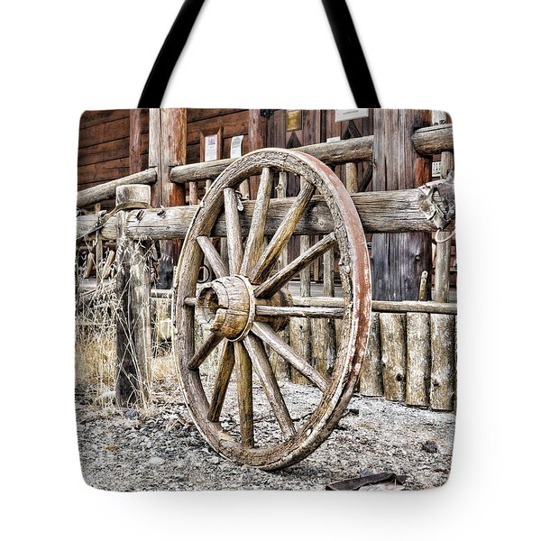 The Wheel Rolls On Tote Bag