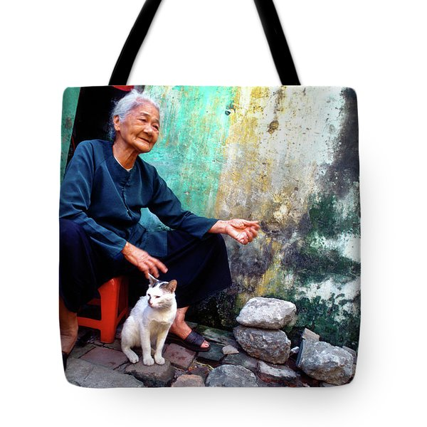Tote Bag featuring the photograph The Woman And The Cat by Silva Wischeropp