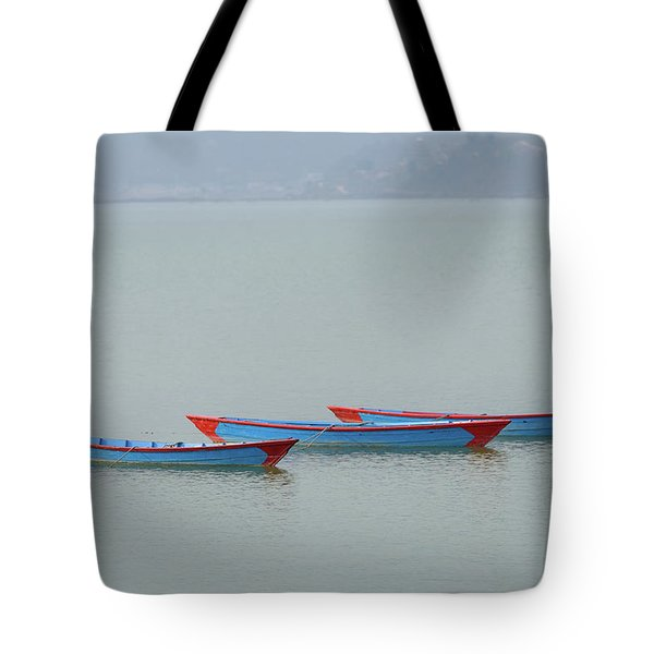 Three Blue Boats On Phewa Lake In Pokhara Tote Bag