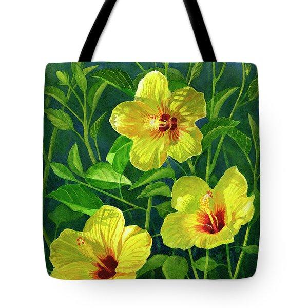 Three Bright Yellow Hibiscus Flowers Tote Bag