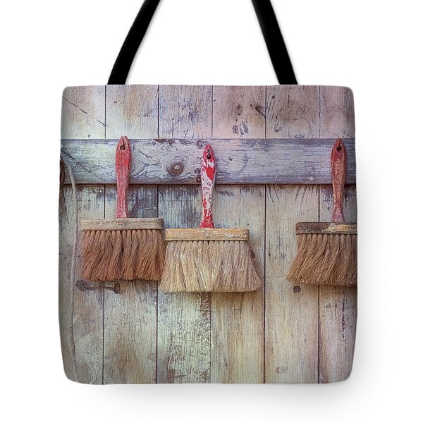 Tote Bag featuring the photograph Three Brushes by Tom Singleton