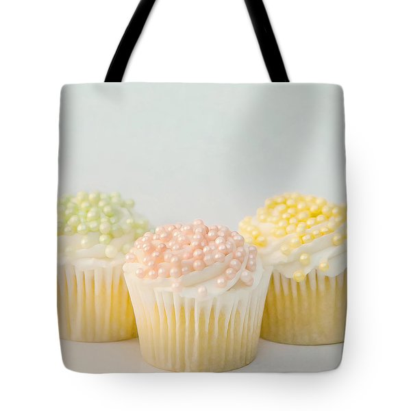 Tote Bag featuring the photograph Three Cupcakes by Art Block Collections