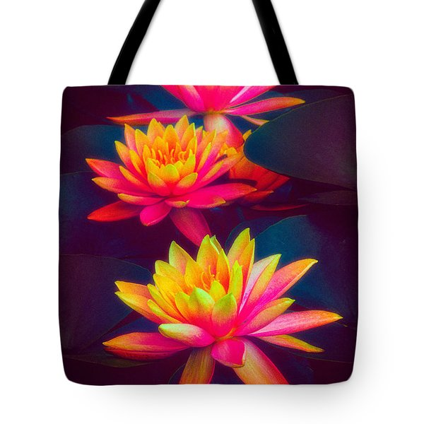 Tote Bag featuring the photograph Three Waterlilies by Chris Lord
