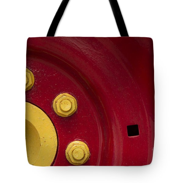 Three Yellow Nuts On A Red Wheel Tote Bag