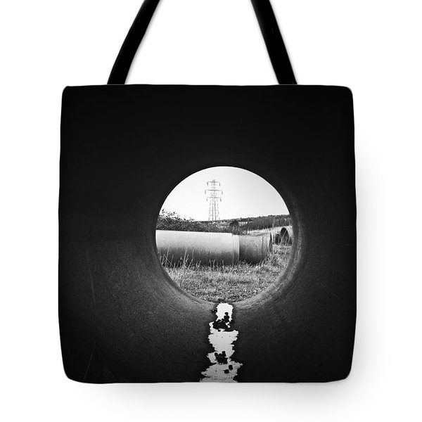 Tote Bag featuring the photograph Through The Pipe by Keith Elliott