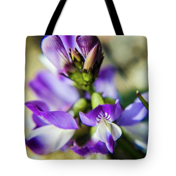 Tote Bag featuring the photograph Tiny Flower by Tyson Kinnison