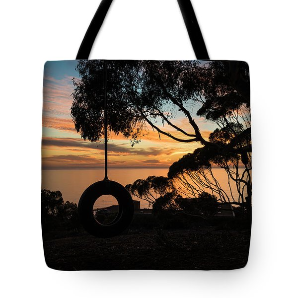 Tire Swing Sunset Tote Bag by Scott Cunningham
