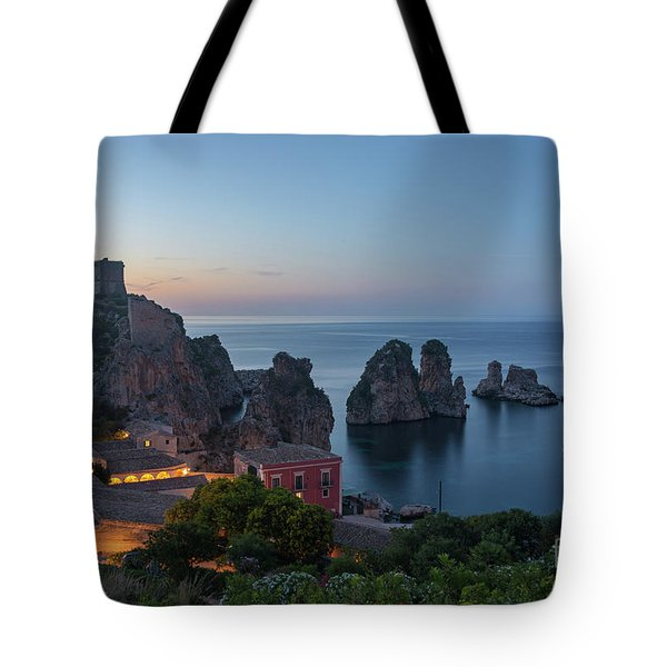 Tote Bag featuring the photograph Tonnara And Faraglioni Rocks In Scopello At Dusk by IPics Photography