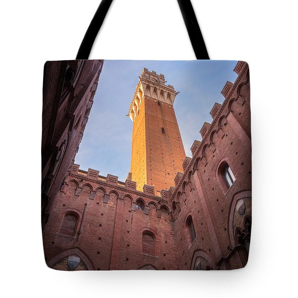 Tote Bag featuring the photograph Torre Del Mangia Siena Italy by Joan Carroll