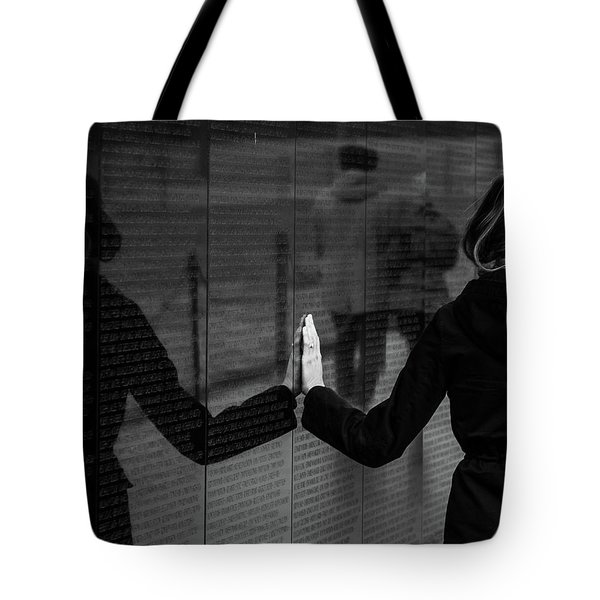 Tote Bag featuring the photograph Touching Moment by Dennis Dame