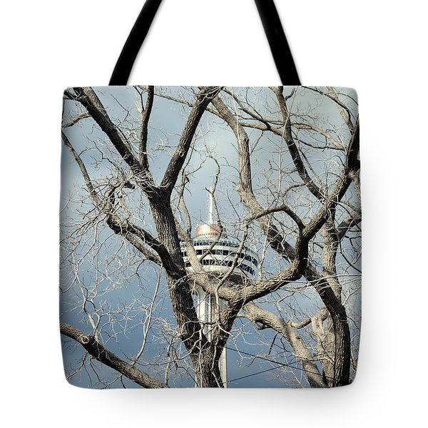 Tote Bag featuring the photograph Tower And Trees by Valentino Visentini