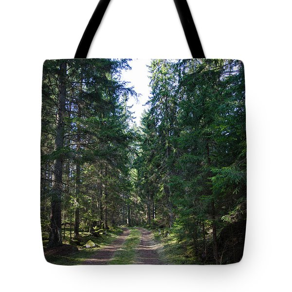 Tote Bag featuring the photograph Tracks In A Coniferous Forest by Kennerth and Birgitta Kullman