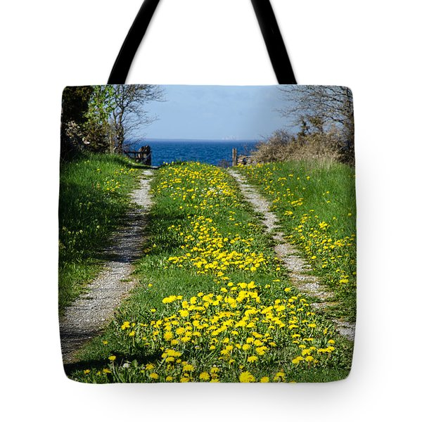Tote Bag featuring the photograph Tracks To The Sea by Kennerth and Birgitta Kullman