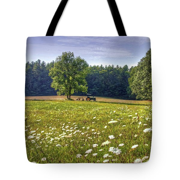 Tractor In Field With Flowers Tote Bag