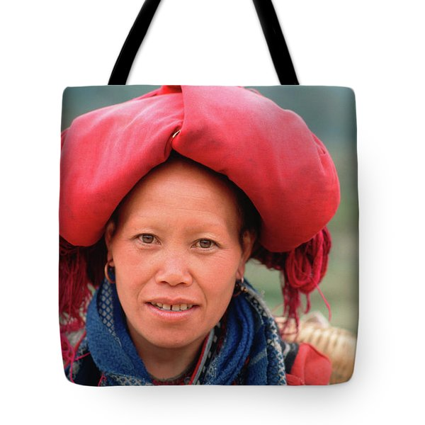 Tote Bag featuring the photograph Traditional Fashion Of A Red Dzao Woman by Silva Wischeropp