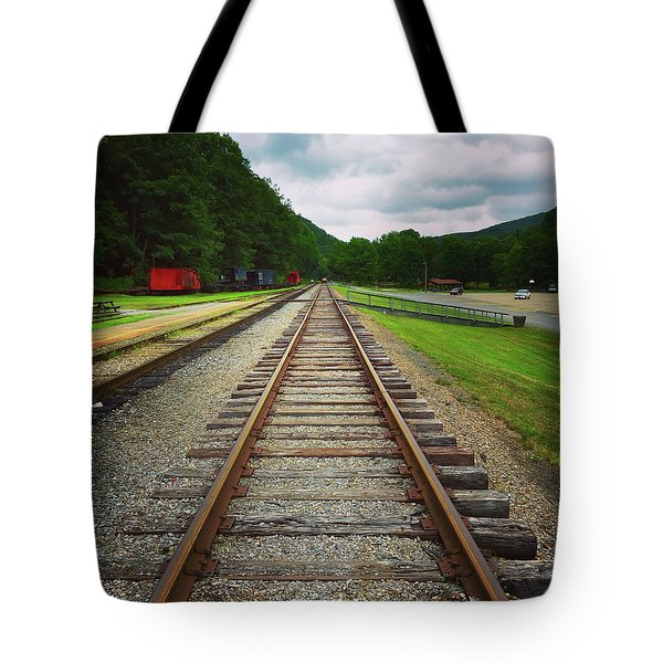 Tote Bag featuring the photograph Train Tracks by Linda Sannuti