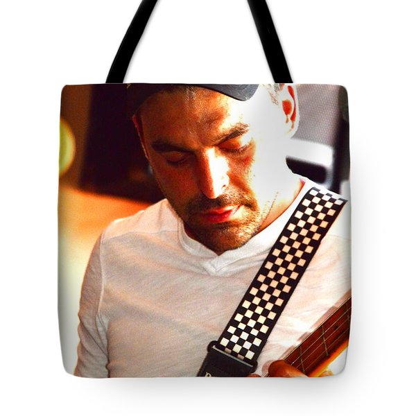 Tote Bag featuring the photograph Trav  'lin by Jesse Ciazza