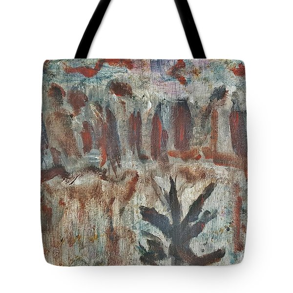 Tree Facing Frozen Lake With Roiling Storm Clouds Rolling In From The Mountain Range Winter With Fal Tote Bag