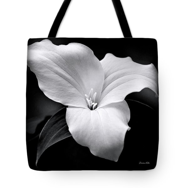 Tote Bag featuring the photograph Trillium Black And White by Christina Rollo