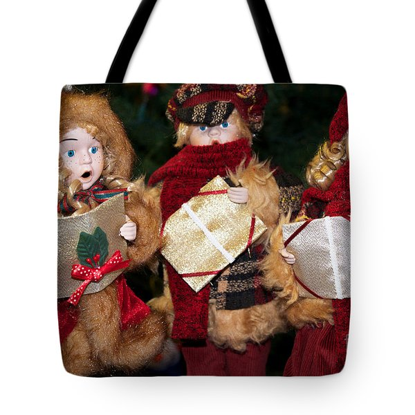 Tote Bag featuring the photograph Trio Of Carolers by Vinnie Oakes