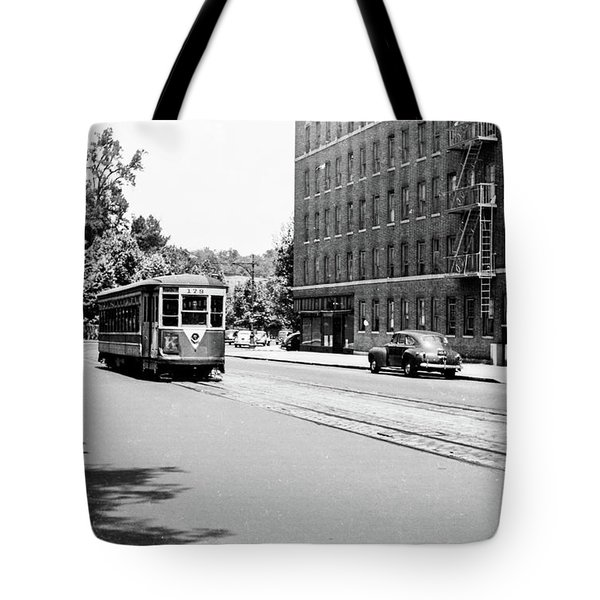 Tote Bag featuring the photograph Trolley With Packard Building  by Cole Thompson