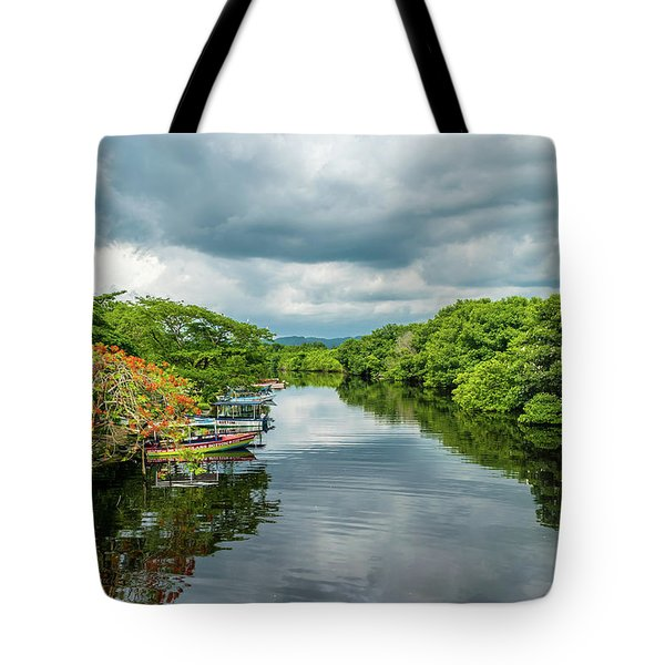 Cloudy Skies Over The River Tote Bag