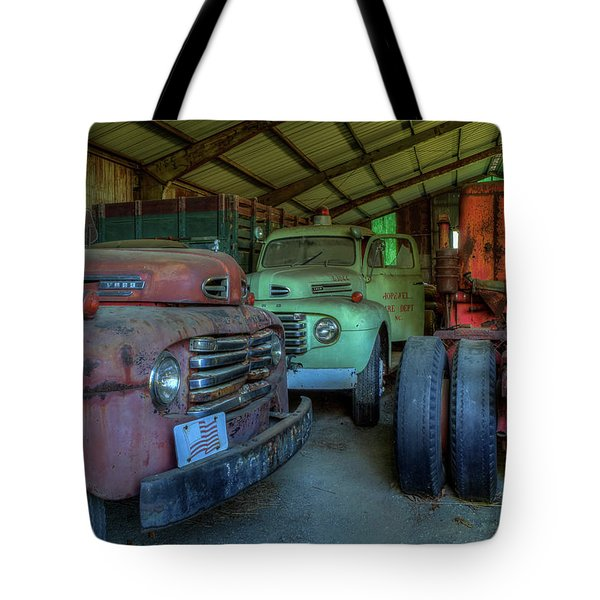 Tote Bag featuring the photograph Truck Graveyard Warehouse by Jerry Gammon