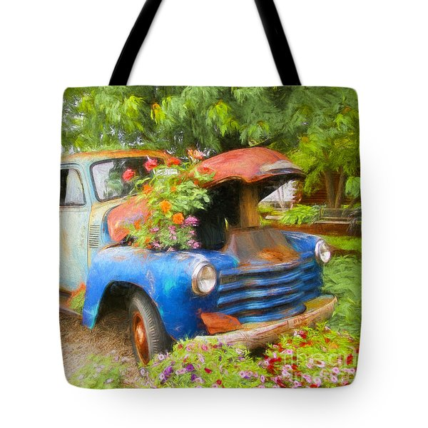 Truckful Of Flowers Tote Bag by Clare VanderVeen