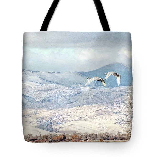 Tote Bag featuring the photograph Trumpeter Swans Winter Flight by Jennie Marie Schell